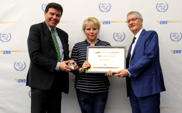EMS Romania receiving their customer care award